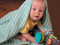 Henry with green baby blanket